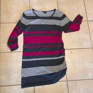 Flattering long pink sweater